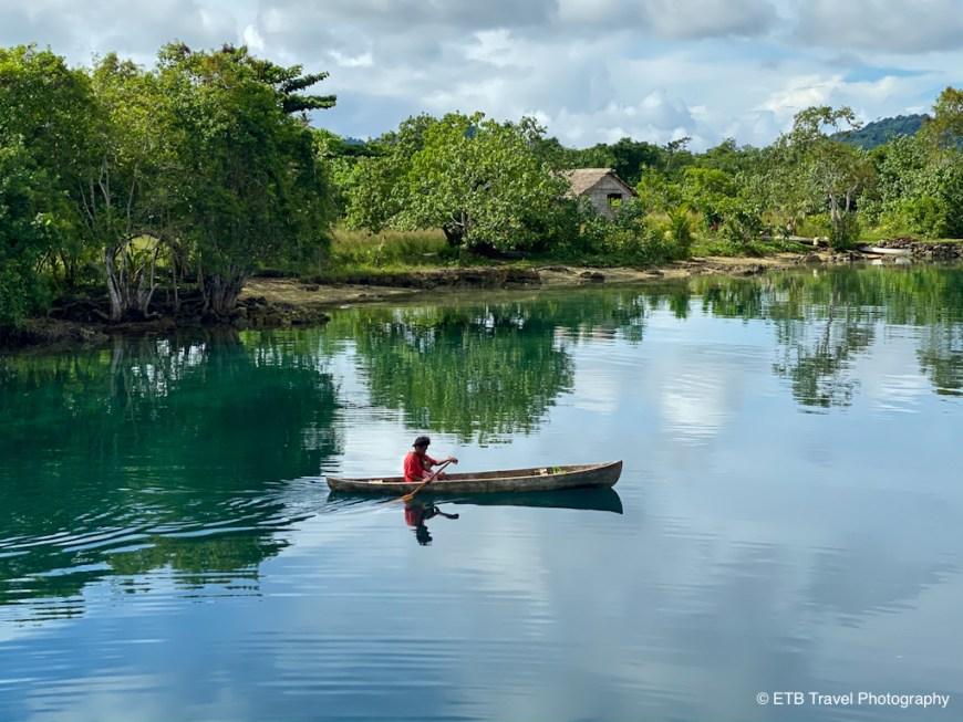 solomon islander rowing canoe