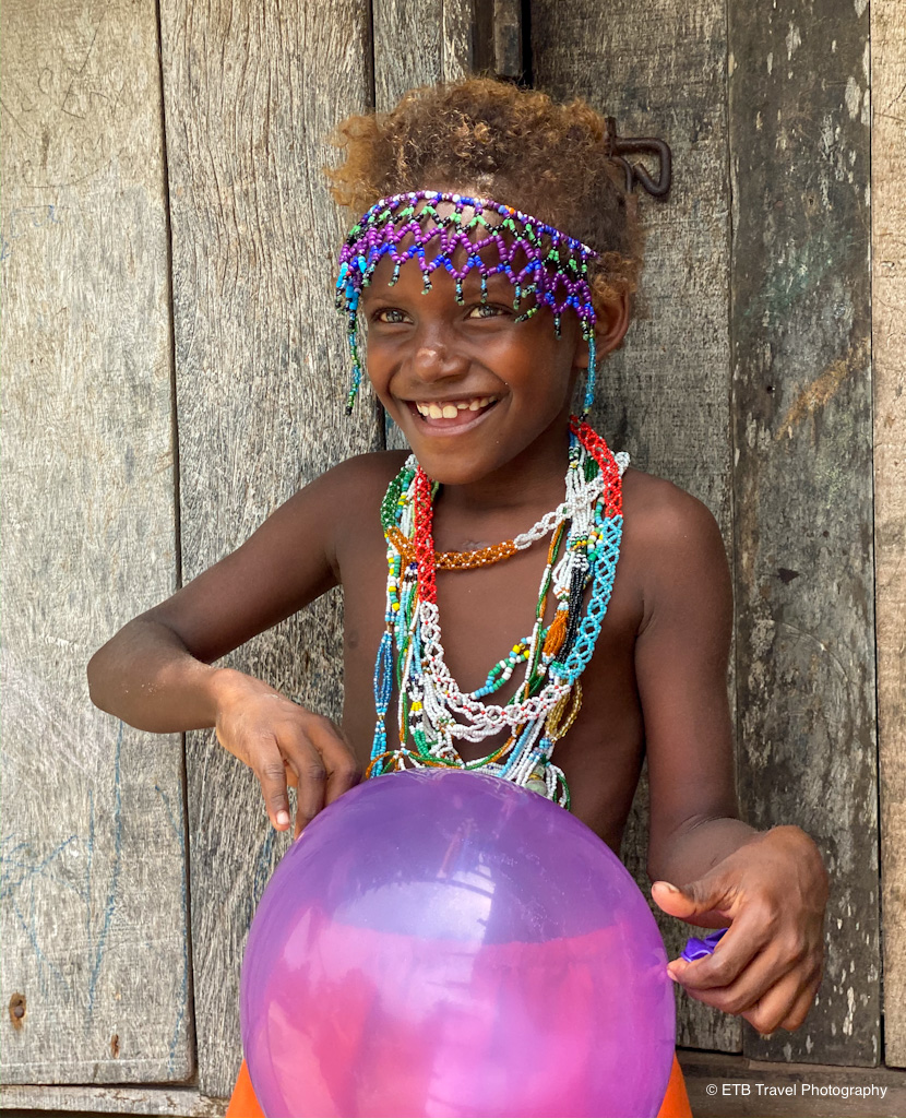 young solomon girl playing with balloon