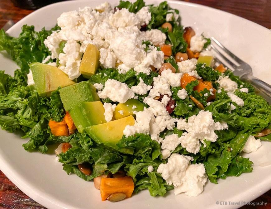 kale salad with feta, avocado, sweet potatoes and pumpkins seeds in panama
