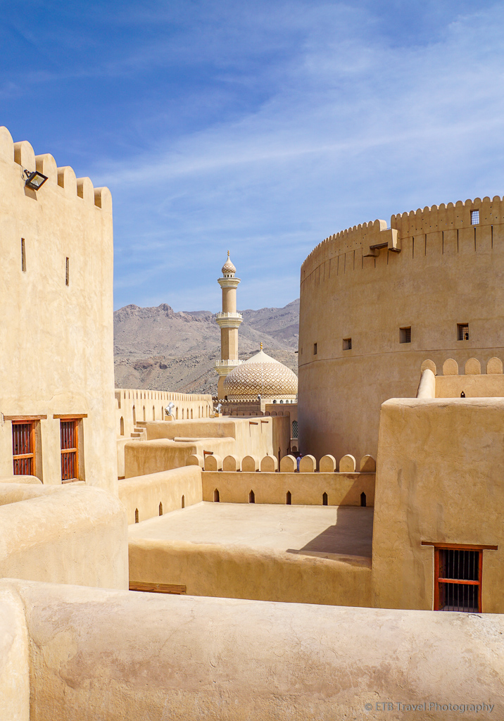 view of mosque and circular tower from castle section of nizwa fort