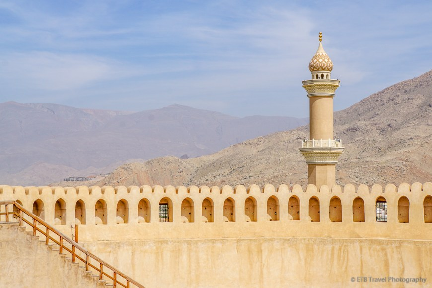 circular tower and minuret at nizwa fort