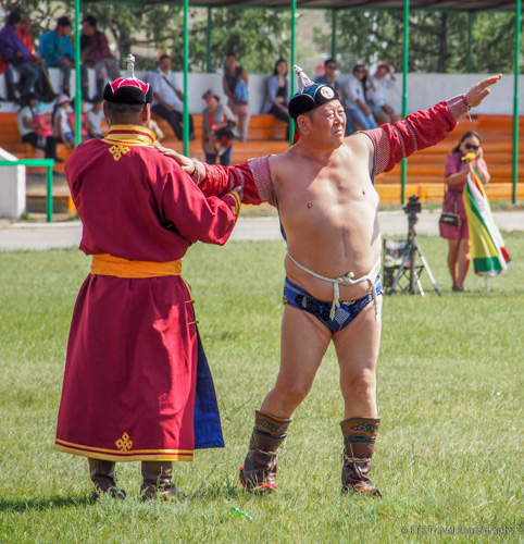 wrestler and hat holder at Naadam