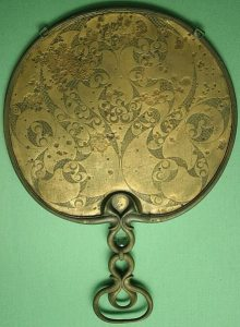 The reverse side of a Romano-Celtic bronze mirror from Desborough, Northamptonshire, England, showing the development of the spiral and trumpet decorative theme of the Early Celtic La Tène style in Britain. This items dates c. 50 BCE-50 CE.