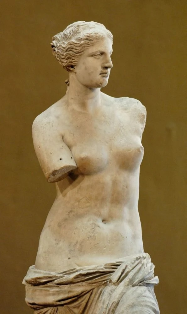 """So-called """"Venus de Milo"""" (Aphrodite from Melos). Parian marble, ca. 130-100 BCE. Found in Melos in 1820 CE. On display at the Louvre, Paris. Photo by Jastrow, Public Domain."""