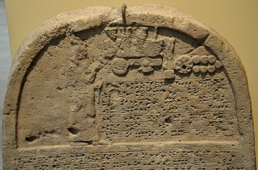 This is the upper par of the limestone stela of Sennacherib, king of Assyrian. The king is praying in front god symbols. From Kuyunjik (modern-day Ninawa Governorate, Iraq). 705-681 BCE.