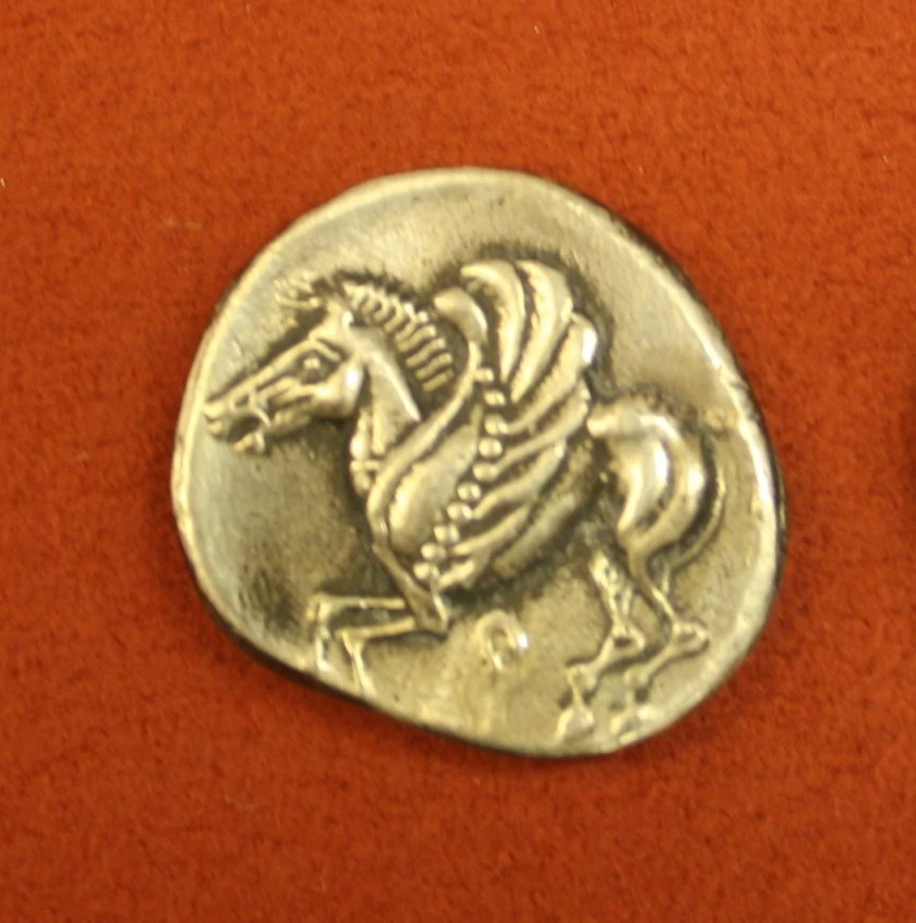Pegasus the winged-horse who was born from the severed head of Medusa and who helped the hero Bellorophon. 6th century BCE coin from Corinth. Alpha Bank Collections, Athens. Photographer: Mark Cartwright