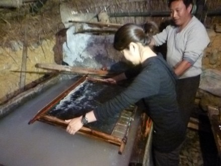 GHF Project Director Han Li scooping paper in China. (Courtesy of GHF.)