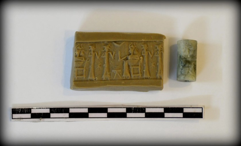 This cylinder seal was unearthed by the French team in 2012 CE from Tell Kunara. The seal dates back to the 3rd millennium BCE. The impression reveals a deity (wearing a horned head cap) sitting on a chair. Before the deity, there is a low table and it seems that 2 things are on the table. The deity greets 2 standing male figures. There is a star between the standing figures. Photo © Osama S. M. Amin.