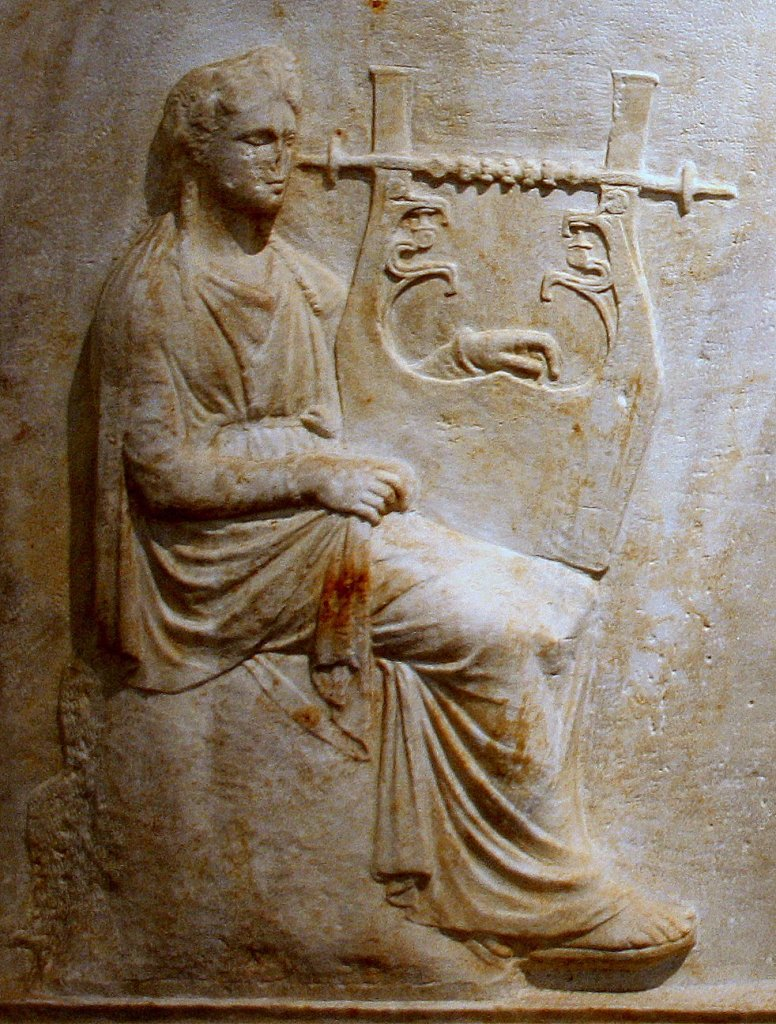 4th centuyry BCE Apollo on a relief slab from Arcadia. (National Archaeological Museum, Athens)