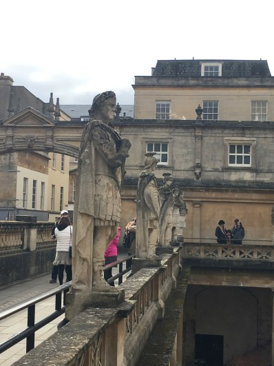 A row of statues of Roman emperors at the Roman baths. Image © Caroline Cervera.