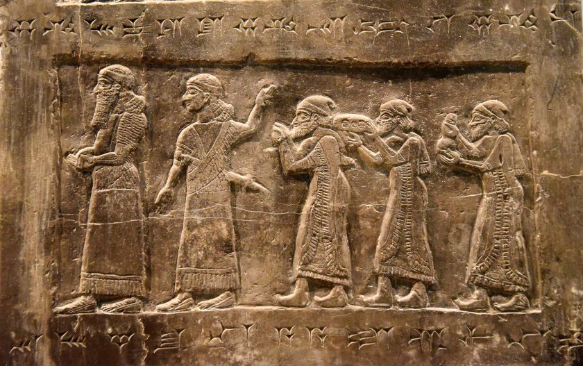 """Side B: There are 2 Assyrian officials and 3 tribute-bearers from Israel; they hold """"silver, gold ... gold vessels ... tin ..."""" Photo © Osama S. M. Amin. Black Obelisk of Shalmaneser III."""