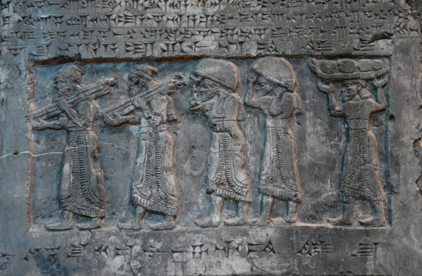 """Side D: There are five tribute-bearers bringing silver, gold, tin, bronze cauldrons (and) the """"staffs of the king's hand"""" from Gilzanu. Photo © Osama S. M. Amin. Black Obelisk of Shalmaneser III."""