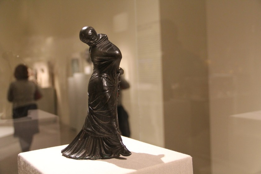 Hellenistic statuette of a veiled and masked dancer, found in Alexandria, Egypt. Image © Caroline Cervera.