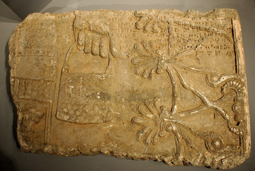 "Gypsum wall relief from the North-West Palace of Ashurnasirpal II. This fragment shows a hand of an Apkallu (Sage) holding a bicket before branches of a sacred tree (the tree of life). Part of the ""Standard Inscription"" of Ashurnasirpal II also appears. This fragment was the only one among all other wall reliefs to undergo conservative work. It is on display within one the halls of the Museum. The Sulaymaniyah Museum, Iraqi Kurdistan. Photo © Osama S. M. Amin."