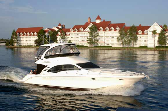 Boat in front of Disney's Grand Floridian Resort & Spa