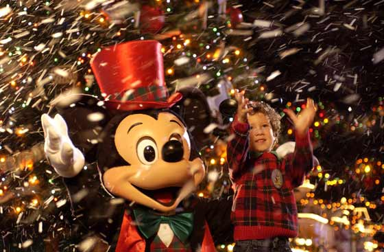 Mickey Mouse and boy celebrating