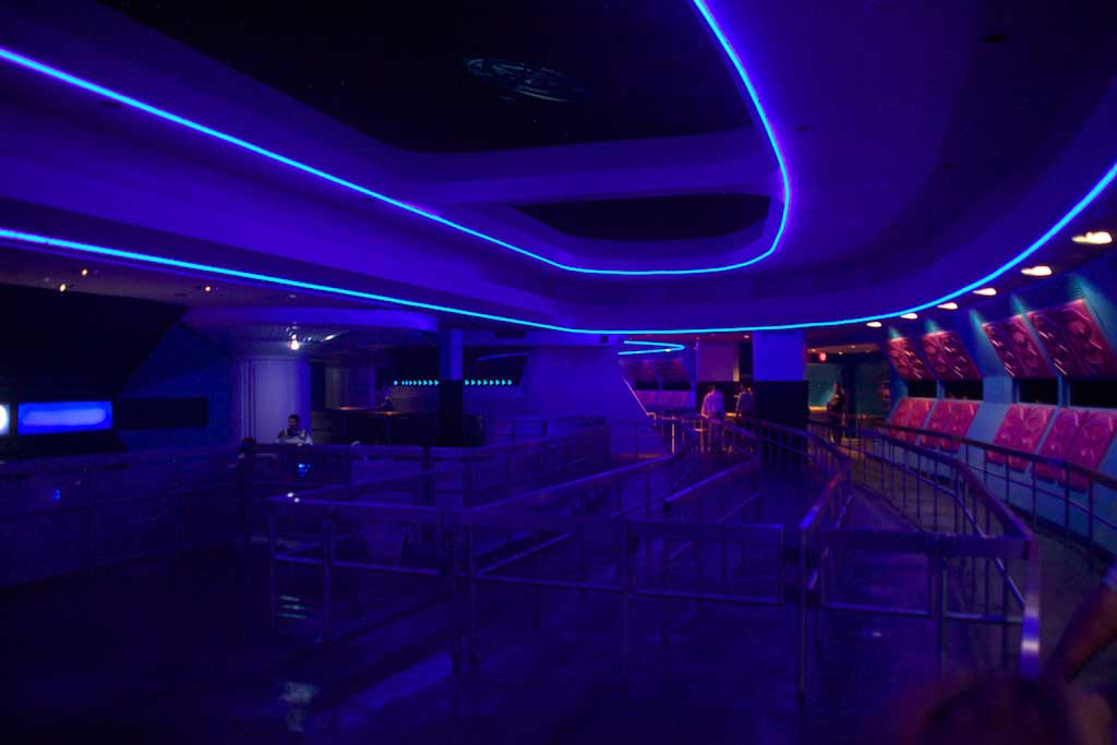Queue area within the cavernous Space Mountain interior.