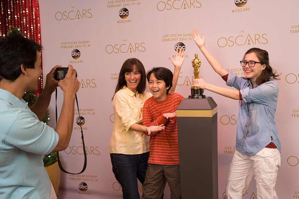 Family holding the Oscar Statuette at Disney's Hollywood Studios