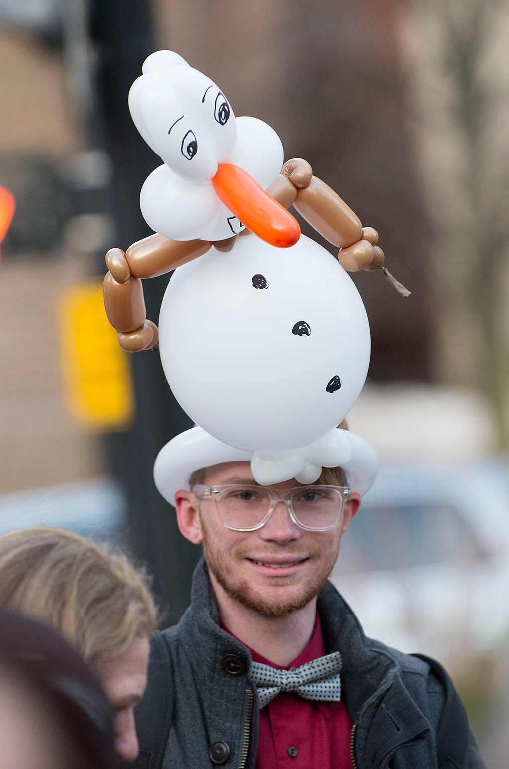 Man with balloon snowman hat
