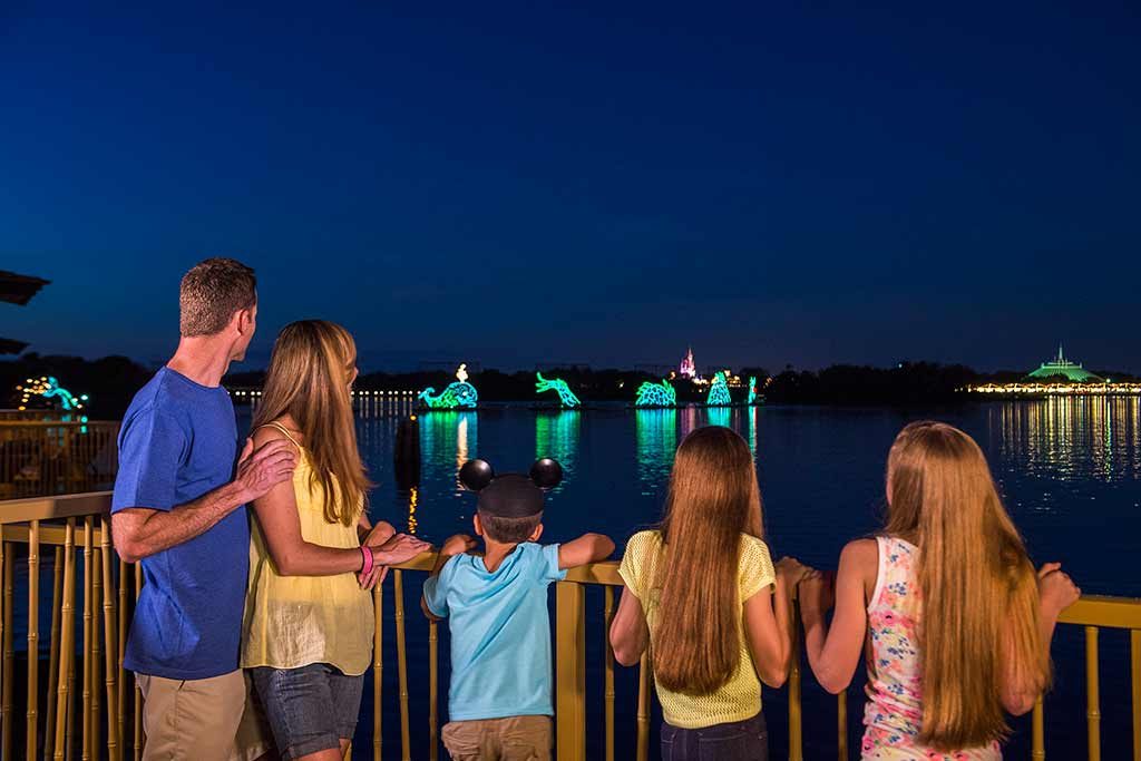 Family watching the light parade from deck