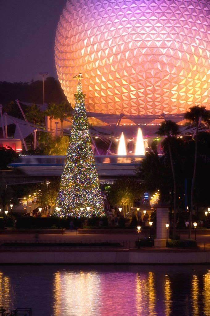 "EPCOT LIGHTS UP THE HOLIDAY NIGHTS:  The giant Christmas tree at Epcot, seen with the park's iconic Spaceship Earth attraction behind it, is the centerpiece of the holiday celebration at the theme park in Lake Buena Vista, Fla.  It's all part of the Walt Disney World theme park's annual ""Holidays Around the World"" celebration, in which international traditions of the season unfold all throughout World Showcase. (Garth Vaughan, photographer)"