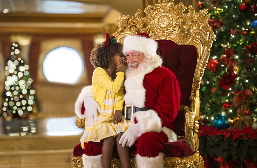 Santa listening to wishes from a little girl