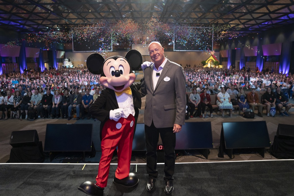 Bob Chapek and Mickey Mouse onstage at D23