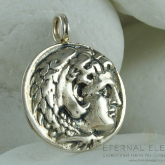 Alexander the Great coin pendant from the A. Leondarakis collection. The pendant is a copy of an ancient Greek coin. On the front it features the head of Alexander the Great while on the back the great King sitting. The pendant is made from solid 925 sterling silver and is discreetly stamped with the metal fineness stamp and the workshop code ΩΙ34. It will be sent to you with a natural leather string in a presentation box for you to keep or present as a gift.