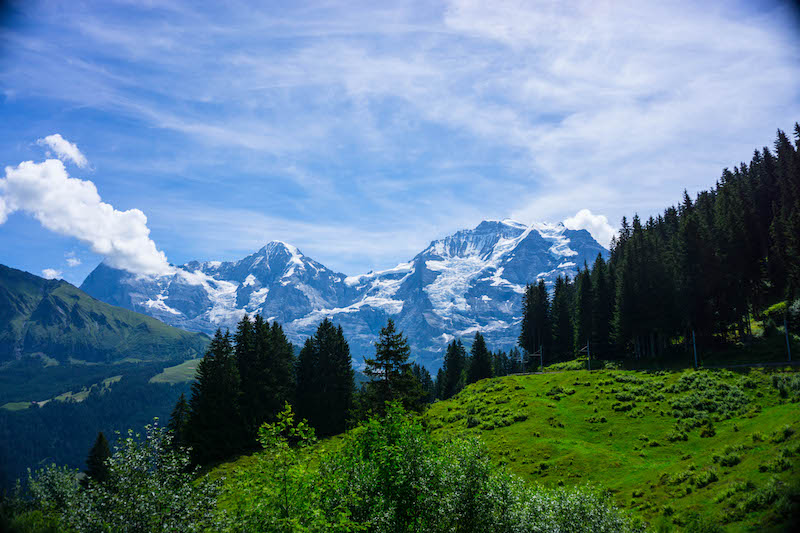 [mountains and fields and blue sky] - off the beaten path Switzerland