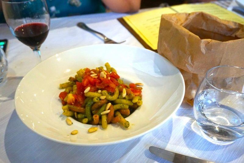 a plate of pesto pasta