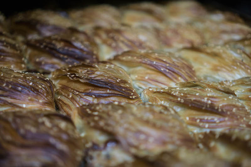 Close up detail of flaky breakfast pastry.
