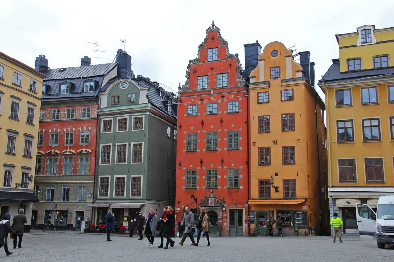 Red, green and yellow house in Gamla Stan, near hostels in Stockholm.