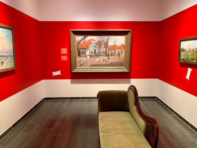 The red walls of a room in the Northern Norwegian art museum