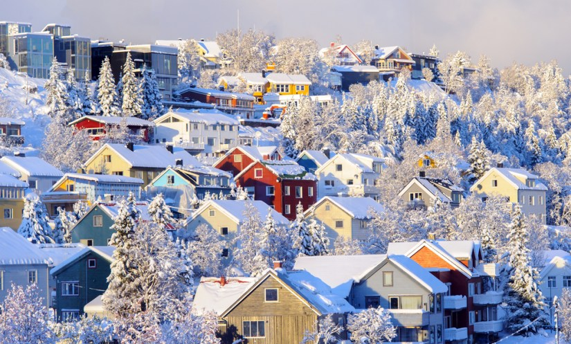 Colorful houses in Tromso Norway with snow all over the place