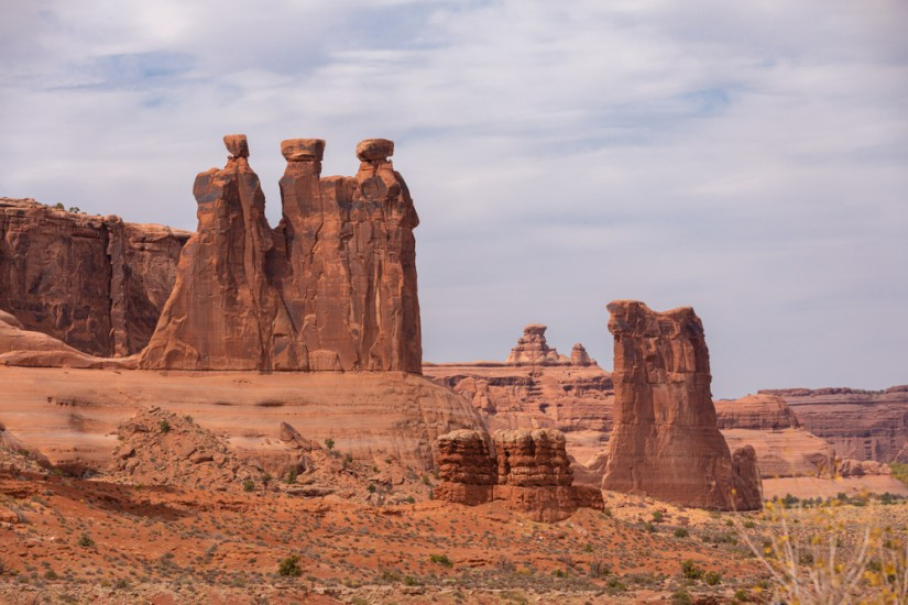 the famous 'three sisters' rock formation seen from the la sal mountains viewpoint in arches national park