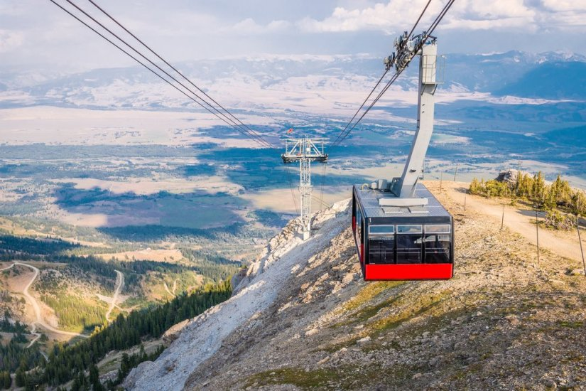 """The famous """"big red"""" gondola in Jackson bringing travelers up to the top of the mountain resort"""