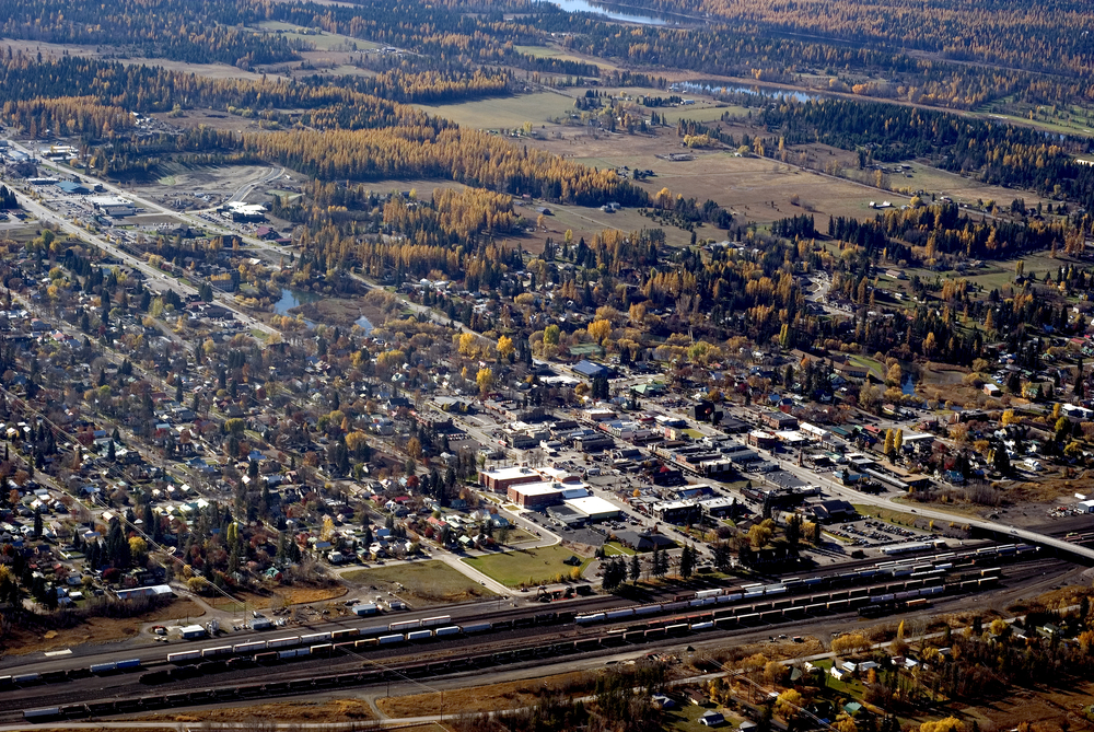 An aerial view of Whitefish Montana in the autumn with some yellowing trees.