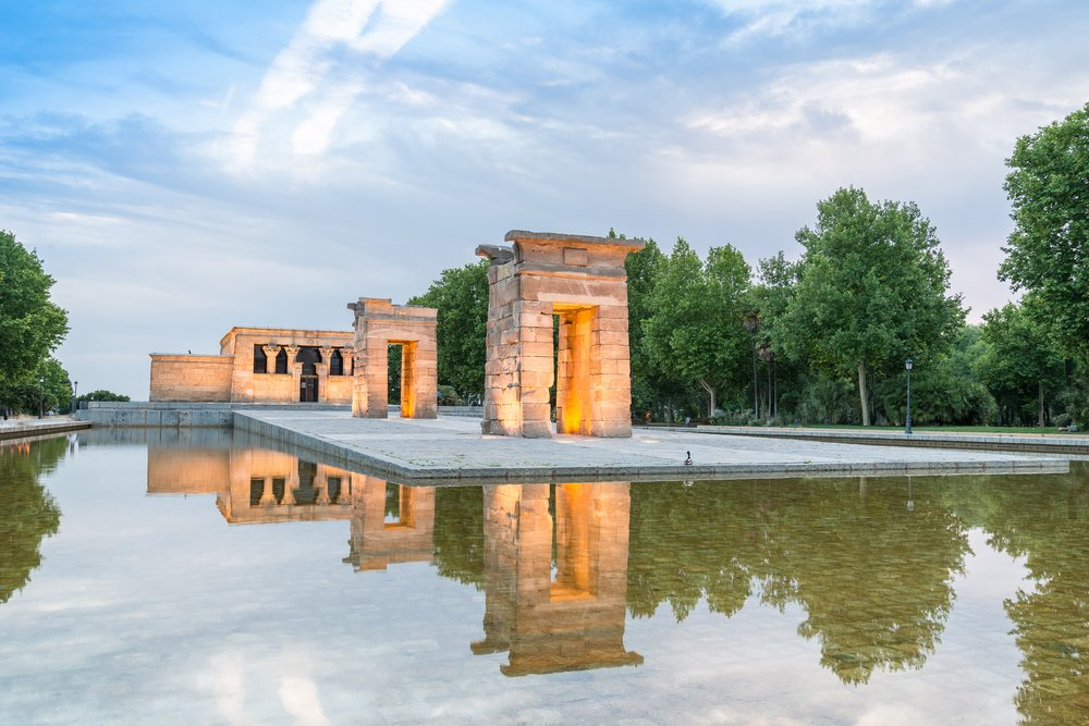 A few arches and a larger stone edifice that make up the Temple of Debod, an actual Egyptian temple in Madrid.