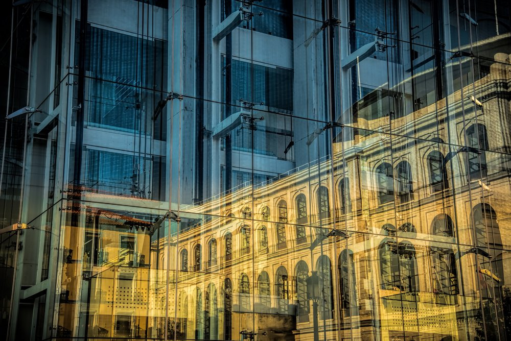 Reflection of a traditional architecture building reflected by a modern building
