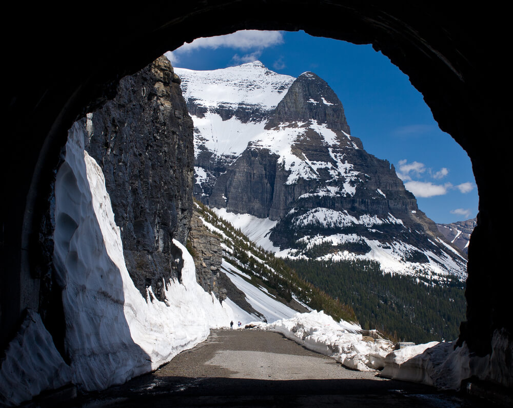 Going to the Sun Mountain from the East Tunnel of the Going to the Sun Road, the sides of the mountain are covered in a light snow, road has been plowed before the road closes in Glacier National Park in winter.