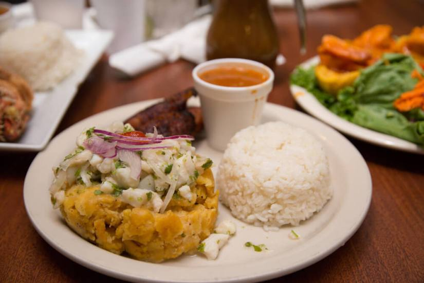 a place of mofongo, rice, and meat, with a salad as well