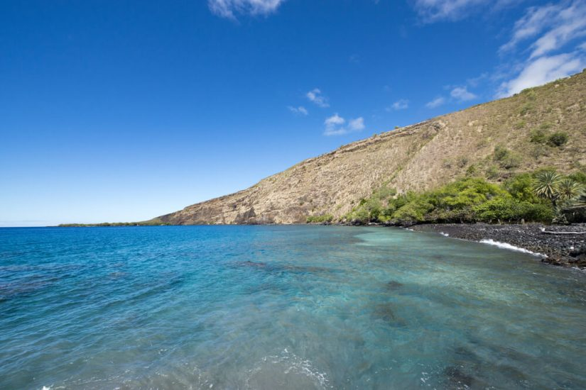 brilliant turquoise waters in a bay in hawaii big island