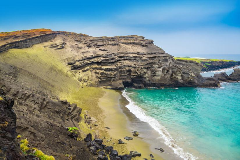 the waters of the green sand beach of hawaii with turquoise water