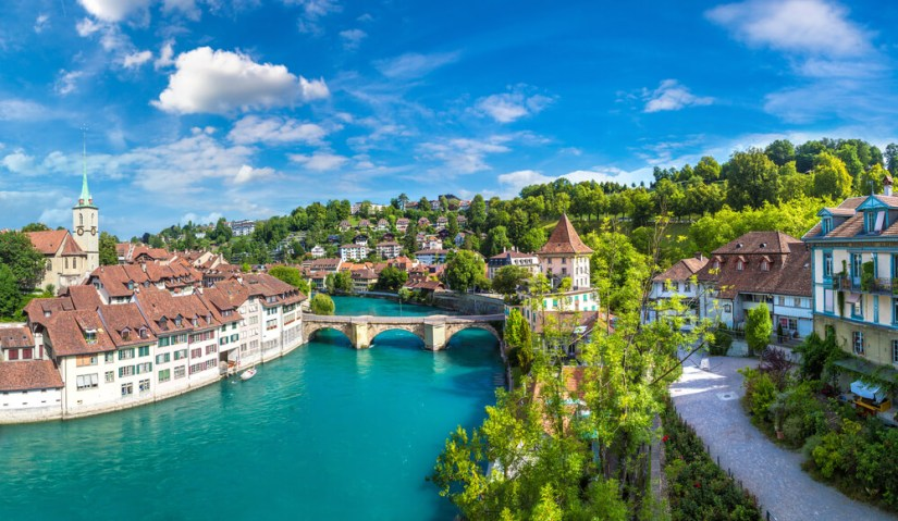 the beautiful aare river which is turquoise and calm flowing through the heart of the old town of bern, the swiss capital city