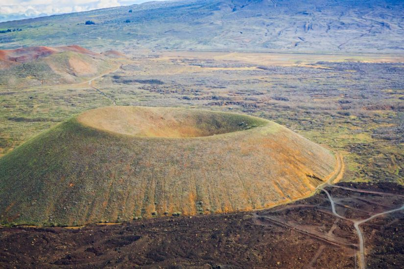 green and orange cinder cone seen from above