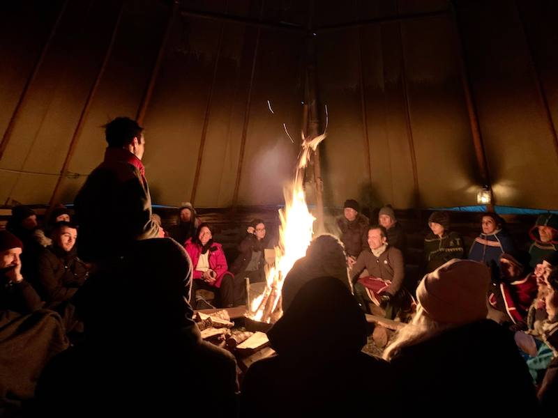 Watching a Sami guide tell stories in a lavvu