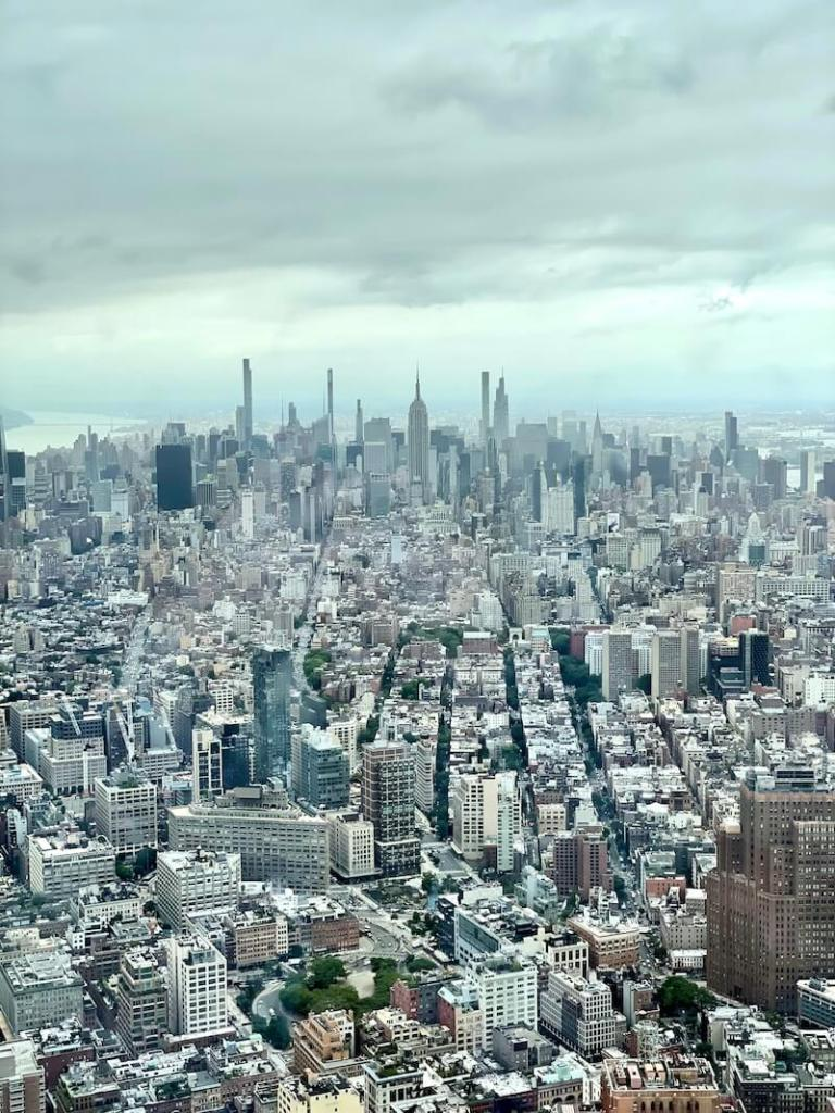View of Uptown Manhattan as seen from One World Observatory on a partly cloudy day