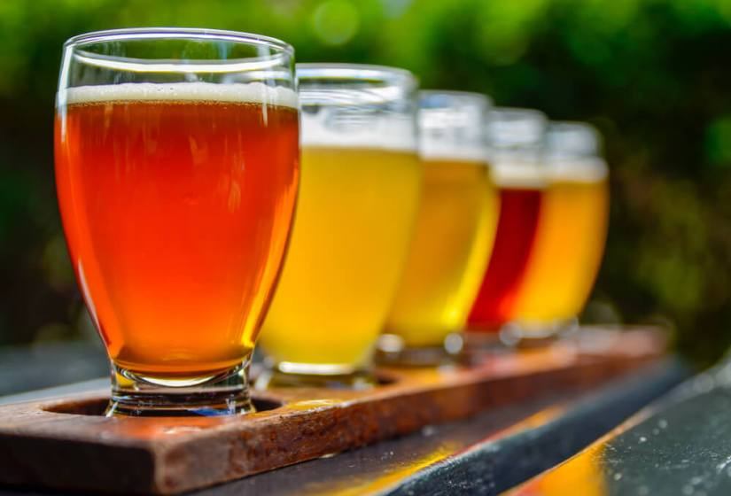 A flight of five colorful ciders