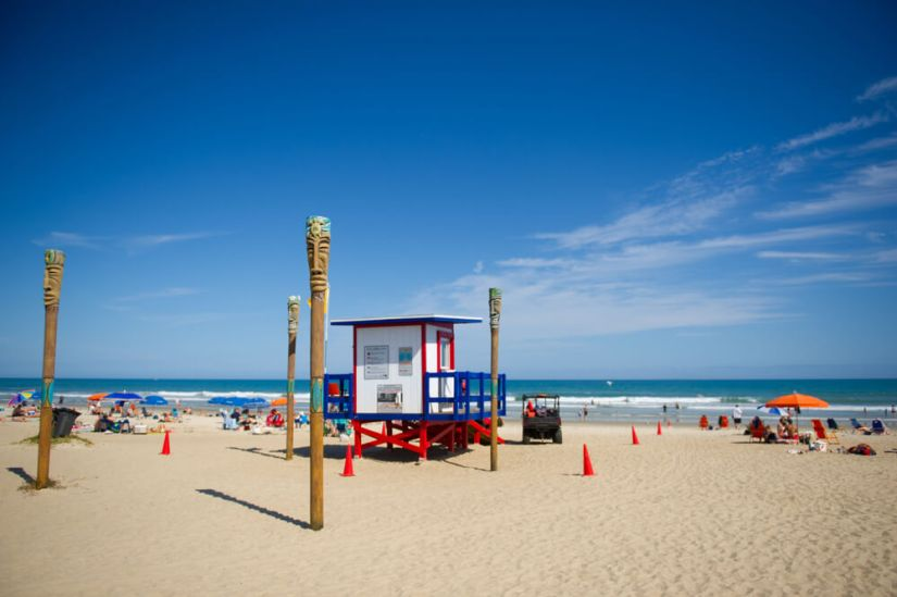 Red white and blue lifeguard stand on the beach in cocoa beach florida