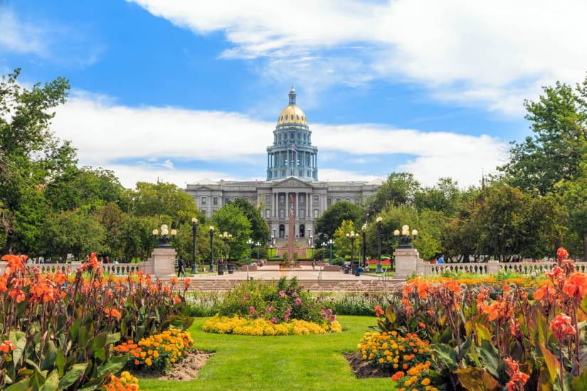 Colorado State Capitol Building in Denver, summer flowers in front of the building on a sunny day